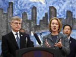 Seattle City Attorney Pete Holmes left looks as Mayor Jenny Durkan right announces on Thursday the city`s intention to vacate misdemeanor marijuana possession convictions